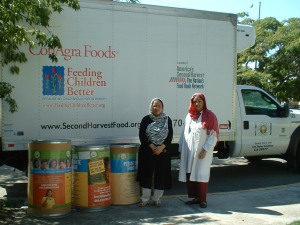 Sabuhi Siddique (left) and Nasreen Malik with food donated to Second Harvest Food Bank