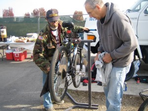 Fixing bikes at homeless event.